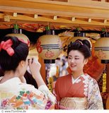 Two geisha girls having fun