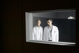 Doctors Looking Through Window