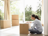 Woman on computer, moving boxes around