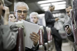 Businessman Reading on a Train