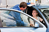Mechanic speaking to woman in car