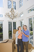 Germany, Bavaria, Grobenzell, Couple celebrating house moving, smiling
