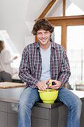 Man peeling vegetables in kitchen