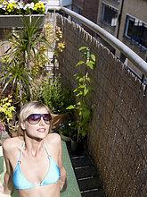 Frau,sonnenbaden,sonnen,Großstadt,Balkon