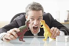 Schreibtisch ,Geschäftsmann ,Spielzeug ,Dinosaurier ,spielen