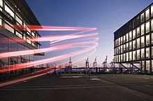 Neumuehlen, modern office buildings, harbour cranes, in the evening, Hamburg, Germany, Europe