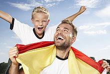 Menschlicher Vater,Sohn,jubeln,Kleidung,Football