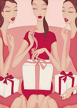 Freundinnen beobachten schöne Frau beim Auspacken der Geschenke