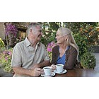 Mature couple having coffee