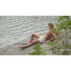 Woman relaxing on Rock von See