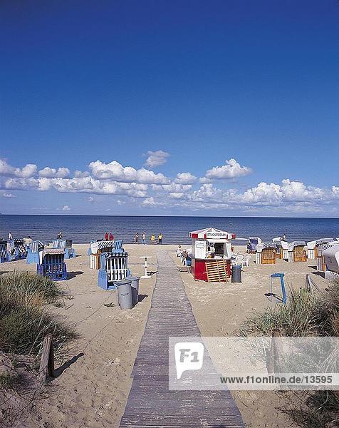 Wicker chairs on beach  Rugen Island  Germany