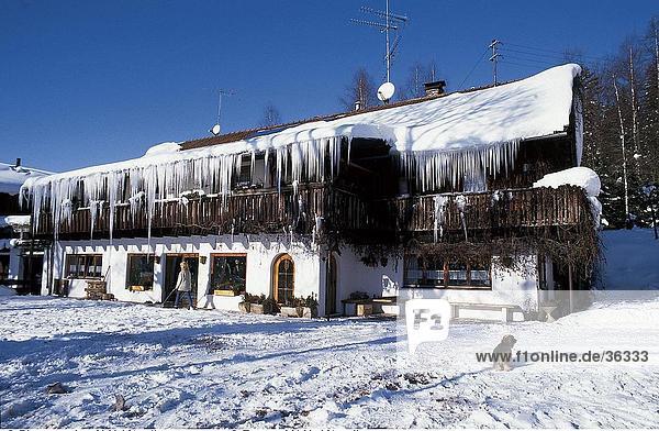 Facade of snow covered farmhouse  Bavaria  Germany