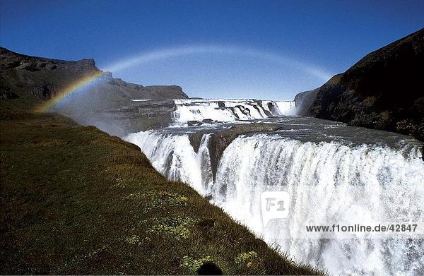 Rainbow over waterfall  Gullfoss Waterfall  Iceland