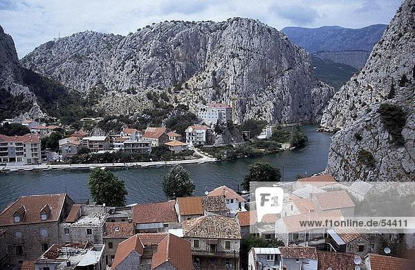 Houses in a town along a river  Cetina River  Omis  Croatia