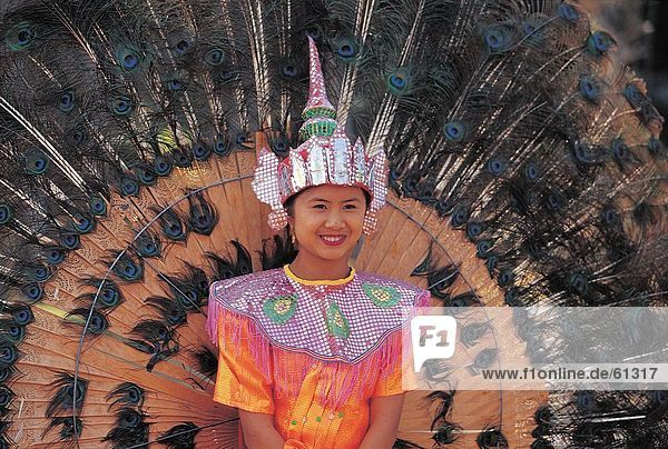 China  ethnische Dai  Frau hält-Dach