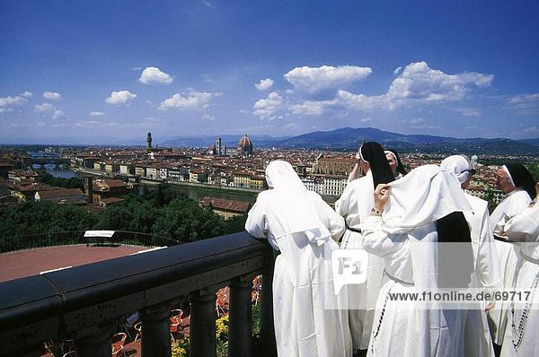 Rear view of nuns at Piazza Michaelangelo  Florence  Italy