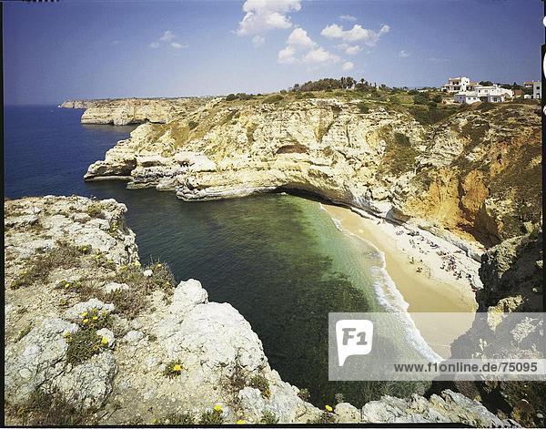 Felsbrocken Landschaftlich schön landschaftlich reizvoll Mensch Menschen Blume Wohnhaus Strand Gebäude Steilküste Meer Algarve Bucht Carvoeiro