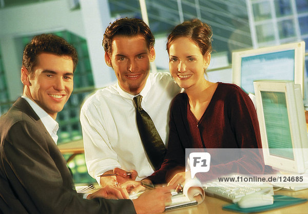 Smiling businesspeople in office
