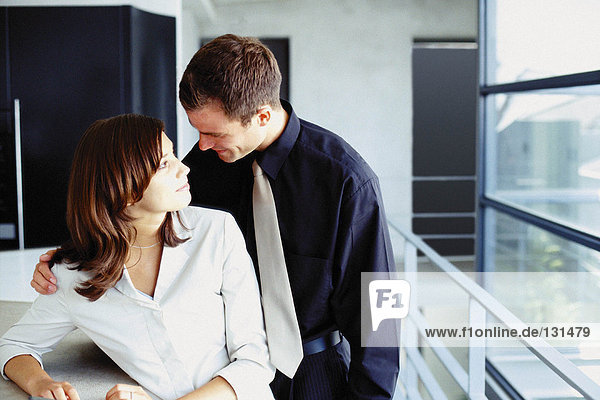 Man and woman cuddling in office