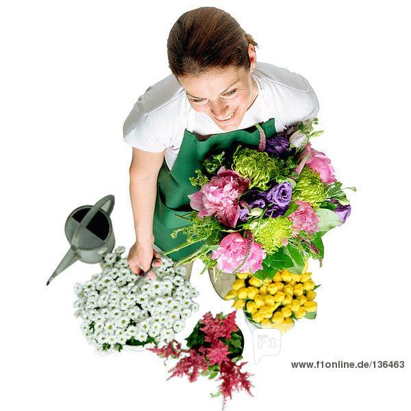 Lächelnder Florist Lächelnder Florist