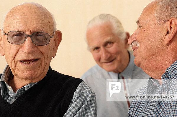 Three elderly men together
