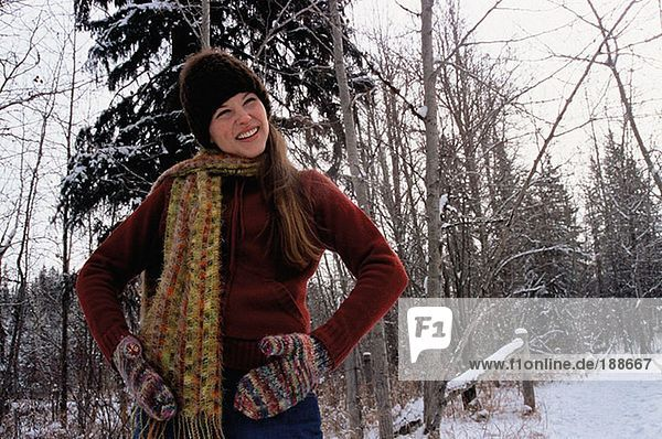 Girl with hands on hips in snow