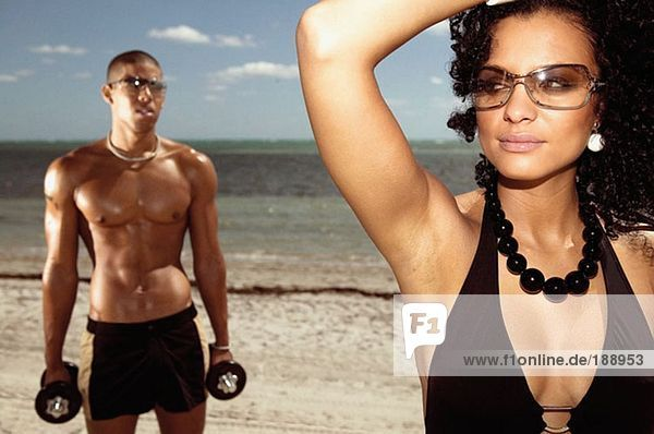 A young man and woman on the beach