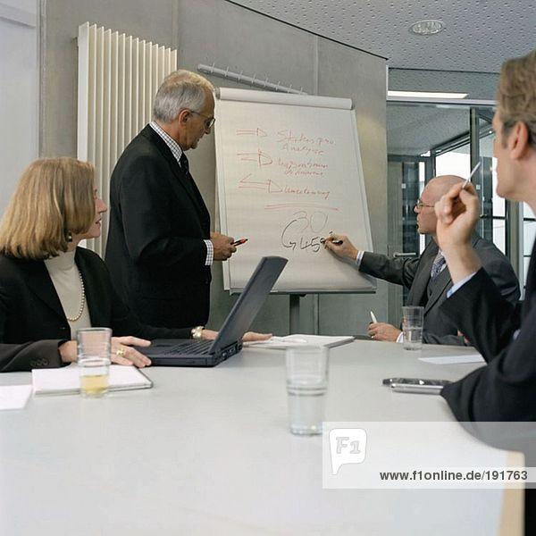 Geschäftsleute in einer Präsentation