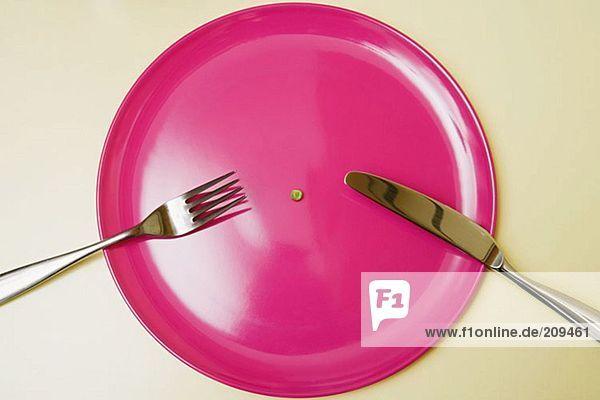 Eine Erbse auf einem Teller
