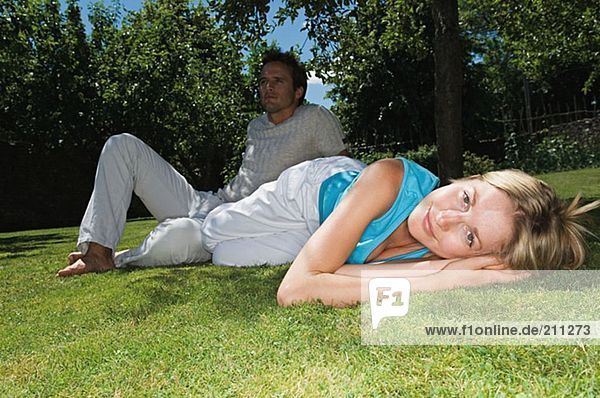 Couple relaxing on the grass