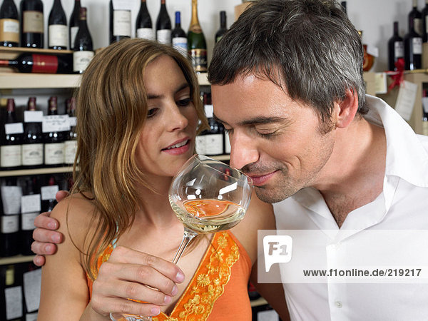 Couple smelling wine