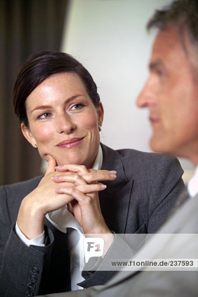 portrait of young businesswoman looking at colleague