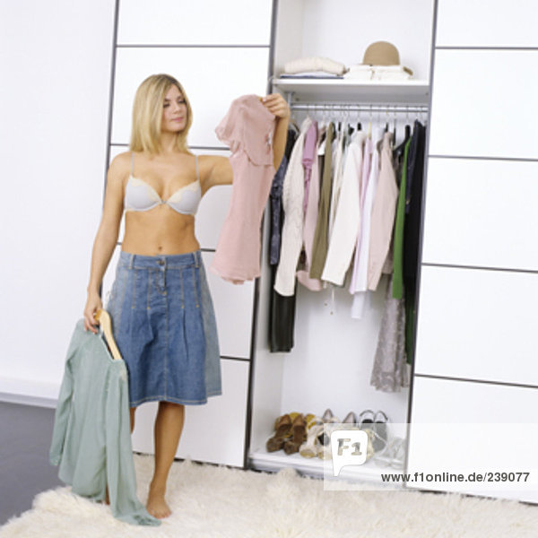 woman getting dressed and choosing what clothes to wear