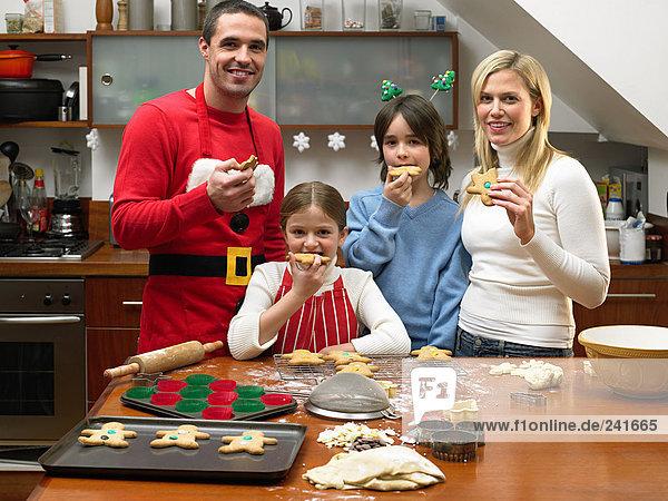 Family eating gingerbread men