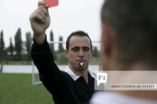 Schiedsrichter zeigt rote Karte  fully_released