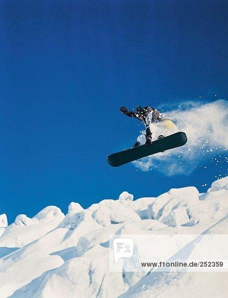 10214479  Bernina area  snow cloud  snowboard driver  jump  from below  winter sports  sport  Snowboarding  snowboardinging