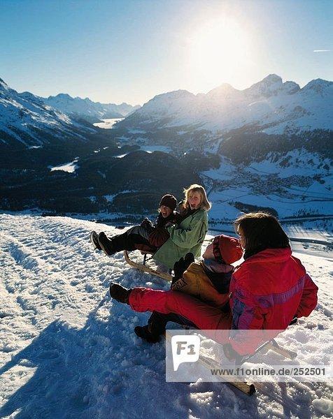 10391099  winter sports  sport  family  winter  sledge  sleigh  fun  joke  women  happily  cheerfully  Graubunden  Grisons  Mu