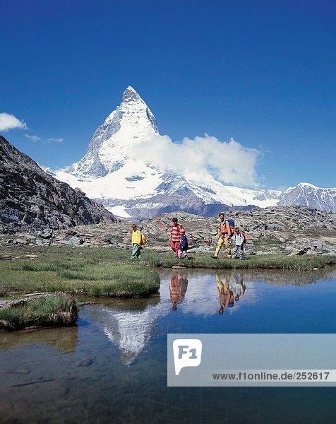 10514018  mountain walking  Alps  mountains  mountain wandering  three  boy  parents  family  canton Valais  Matterhorn  landm