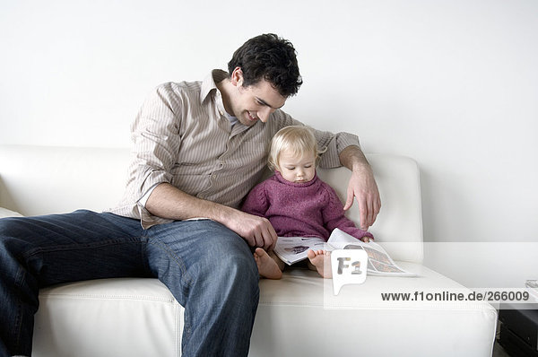 Man and little boy reading