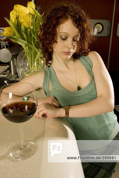 Young woman waiting in bar