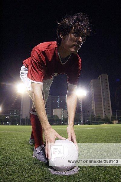 Fußball-Spieler einen Elfmeter festlegen