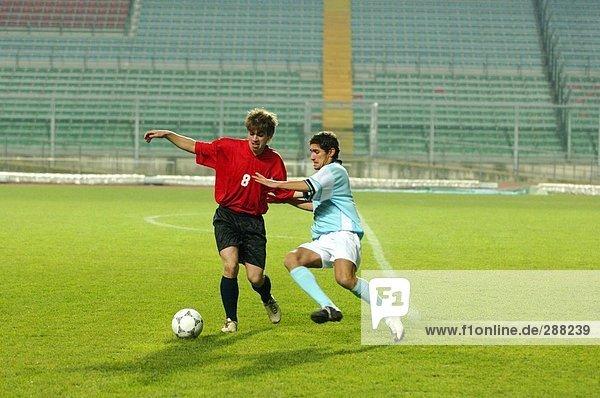 Soccer Player Tackling