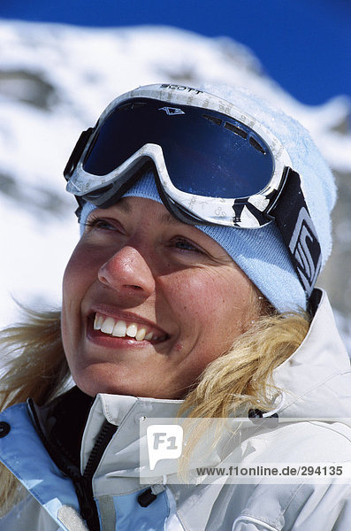 Portrait of a woman wearing ski goggles.