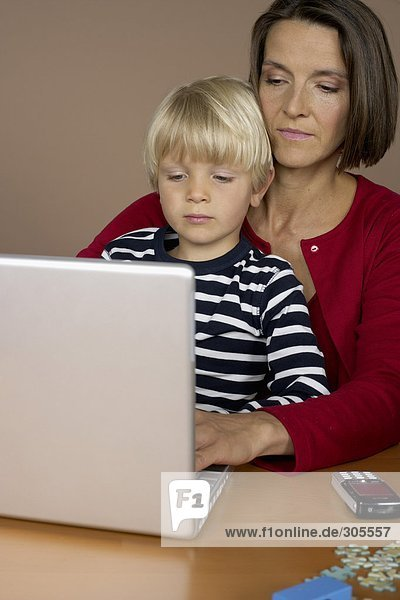 Mother and son (4-5 Years) using a laptop