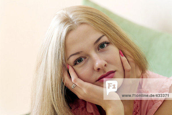 portrait of thoughtful looking young woman