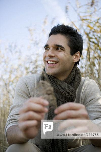 portrait of smiling man in field