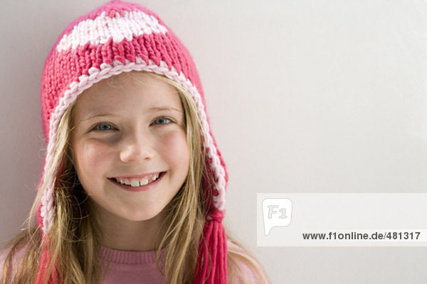 girl with pink woollen hat smiling
