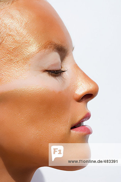 Profile of sunburnt woman