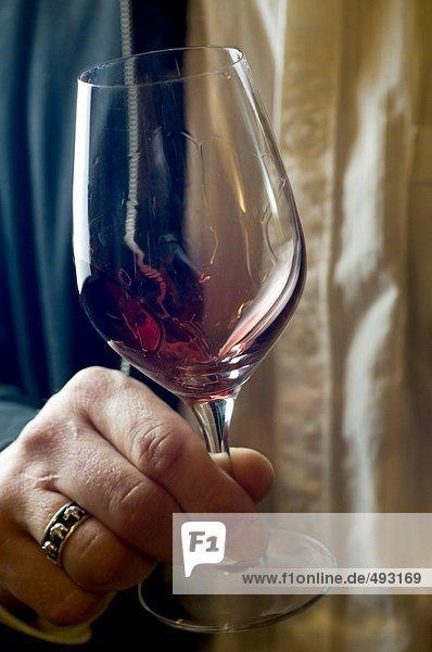 Woman holding a wineglass.