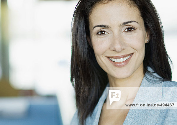 Businesswoman smiling at camera  portrait